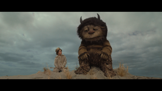 still from 'Where The Wild Things Are' of Max (Max Records) and Carol (voiced by James Gandolfini)